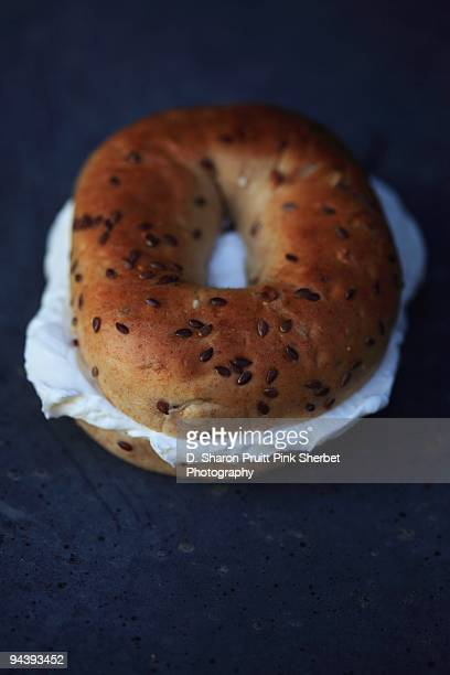 Whole Wheat Bagel With Cream Cheese On Dark Bl