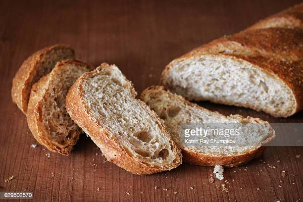 100% whole wheat baguette. sliced - baguette stock pictures, royalty-free photos & images