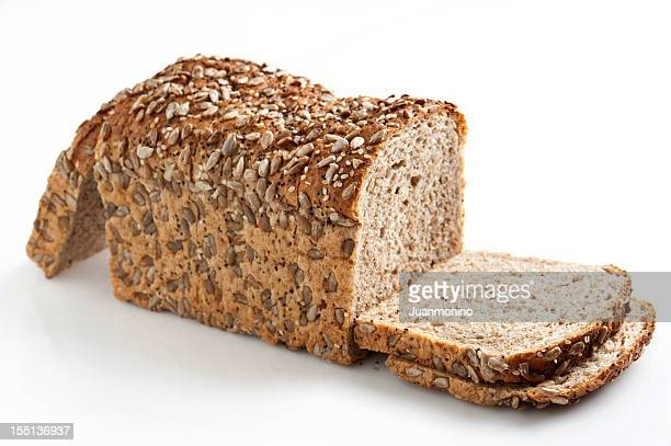whole wheat bread with seeds - loaf of bread stock pictures, royalty-free photos & images