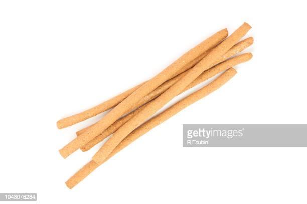 whole wheat breadsticks isolated on white background - colina fotografías e imágenes de stock