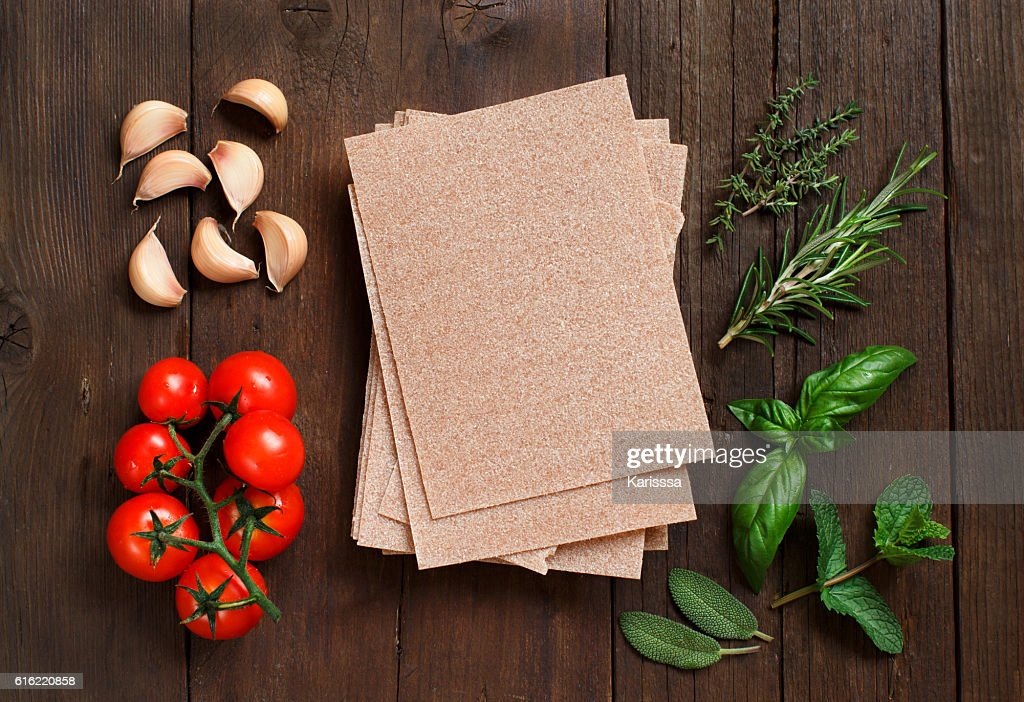 Whole wheat lasagna sheets, vegetables and herbs : Stock Photo