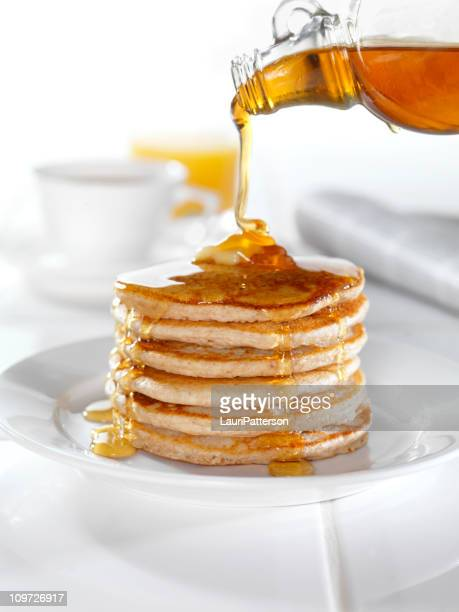 whole wheat pancakes with maple syrup - pancake stock pictures, royalty-free photos & images