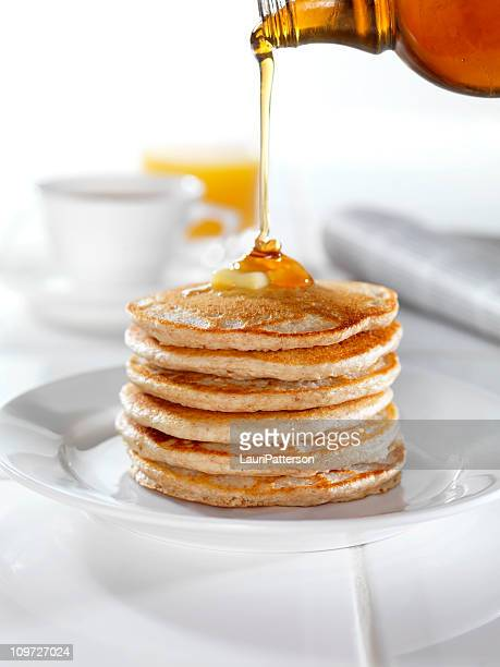 whole wheat pancakes with syrup and butter - pancake stock pictures, royalty-free photos & images