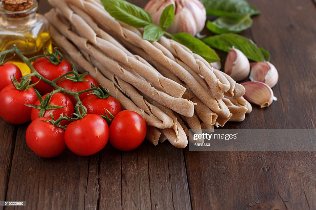 Whole wheat pasta, vegetables,  herbs and olive oil : Stock Photo