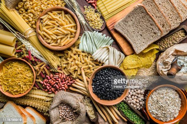 wholegrain and dietary fiber food on rustic wooden background - rice cereal plant stock pictures, royalty-free photos & images