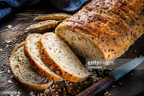 wholegrain and seeds sliced bread - loaf of bread stock pictures, royalty-free photos & images
