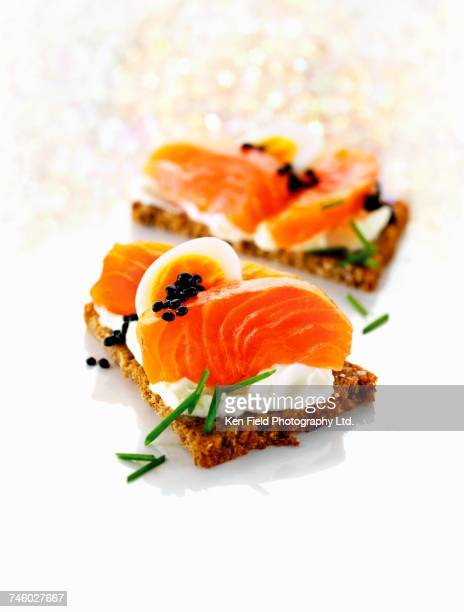 whole-grain bread with cottage cheese, salmon, egg and caviar - canap�� photos et images de collection