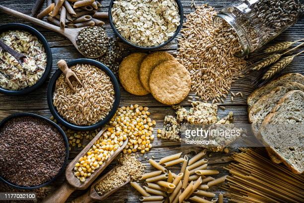 wholegrain food still life shot on rustic wooden - gluten free bread stock pictures, royalty-free photos & images
