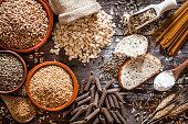 Wholegrain food still life shot on rustic wooden table