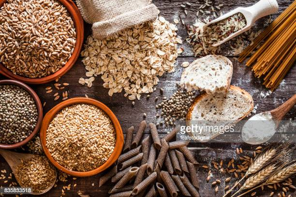 wholegrain food still life shot on rustic wooden table - manufactured object stock pictures, royalty-free photos & images