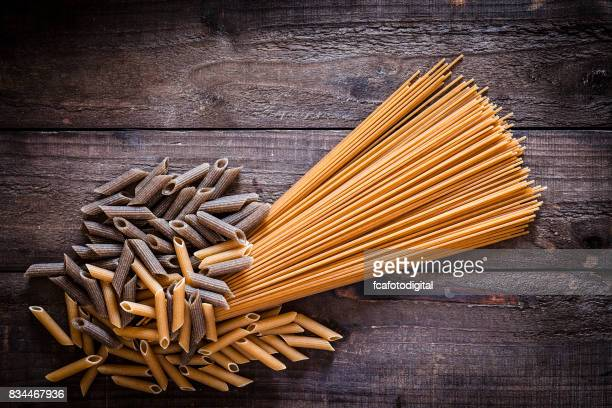 Wholegrain pasta on rustic wooden table