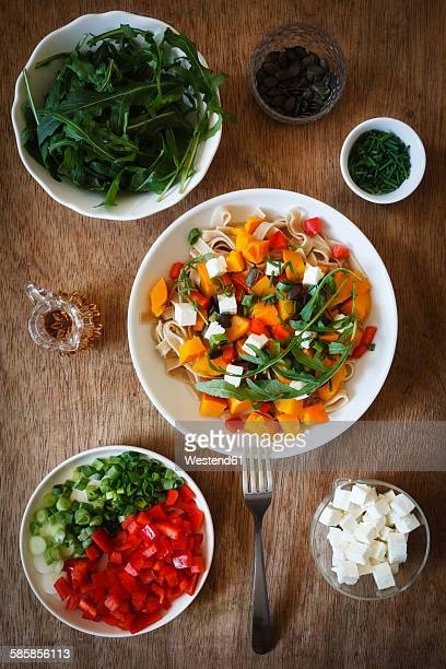 Whole-grain pasta with pumpkin and different toppings