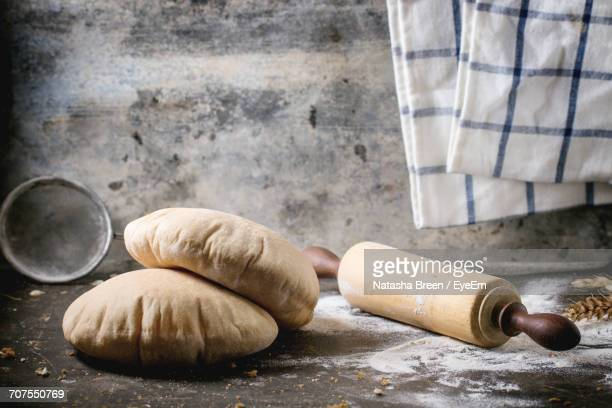 Wholegrain Pita Bread With Rolling Pin On Table