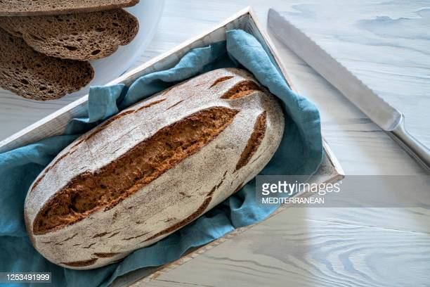 wholegrain rye bread loaf on white wooden background - gluten free bread stock pictures, royalty-free photos & images