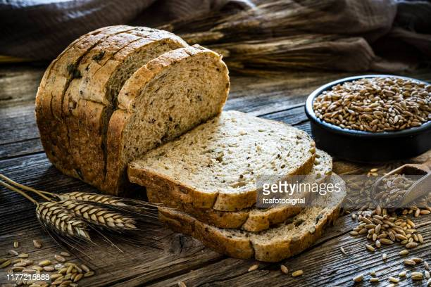 wholegrain sliced bread - bread stock pictures, royalty-free photos & images
