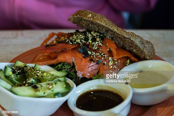 wholemeal bagel with smoked wild salmon, sesame seeds and wasabi - wasabi sauce stock pictures, royalty-free photos & images