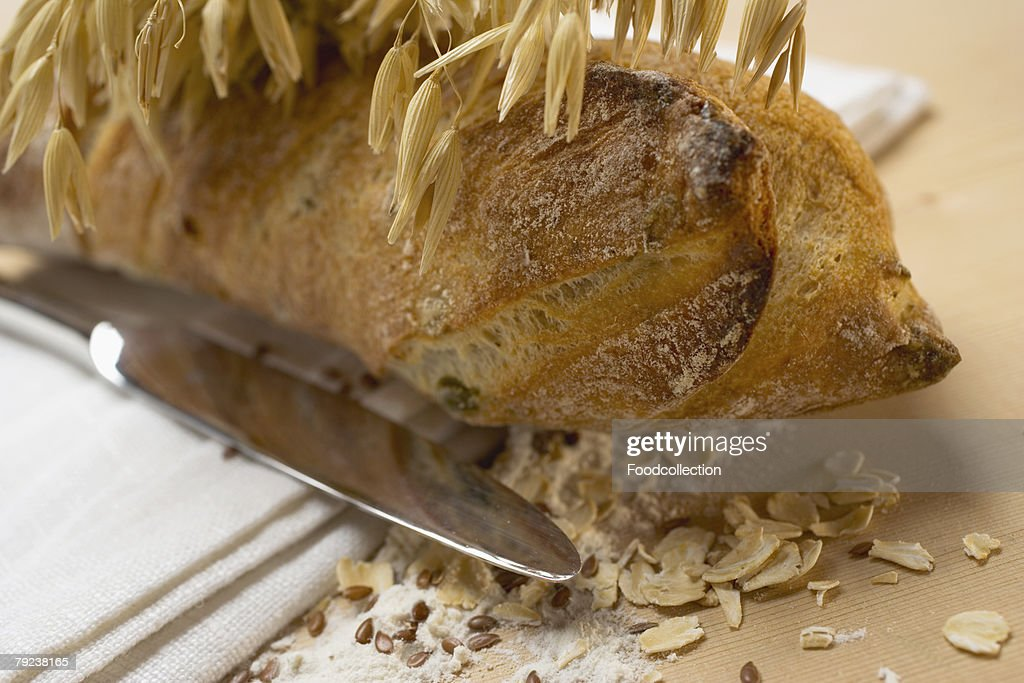 Wholemeal baguette with cereal ears and ingredients : Stock Photo