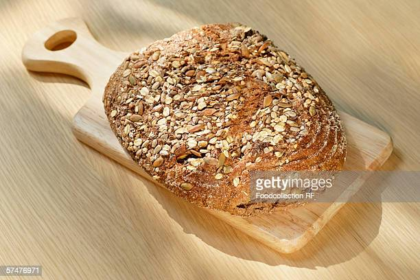 Wholemeal bread on a small wooden board