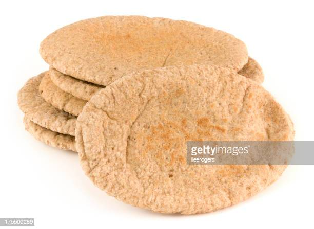 Wholemeal pita breads isolated on a white background