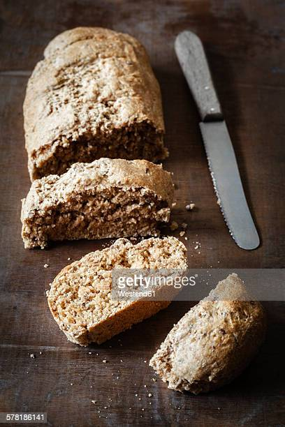 Wholemeal spelt baguettes and knife