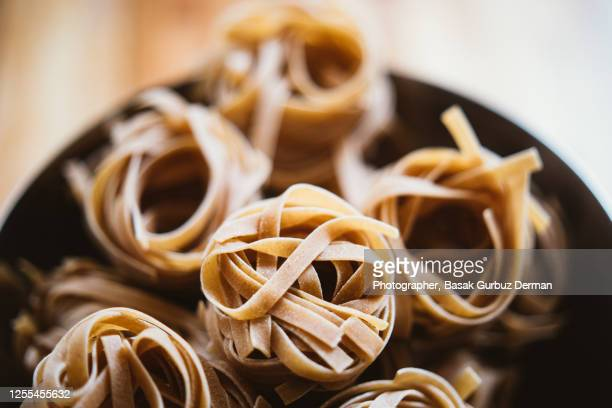 wholemeal tagliatelle - home made stock pictures, royalty-free photos & images