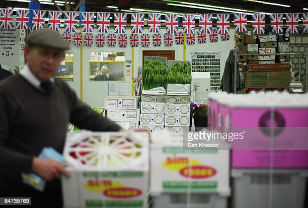 Wholesale traders work in New Covent Garden Flower Market on February 11 2009 in London England New Covent Garden Flower Market is London's premier...