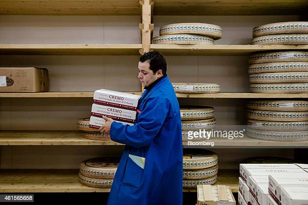 A wholesaler carries boxes of cream cheese in the dairy section of Rungis wholesale food market in Rungis France on Thursday Jan 15 2015 Bank of...