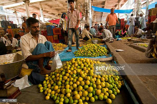 A wholesaler selling vegetables in Azadpur Vegetable Whole Market on September 25 2014 in New Delhi India
