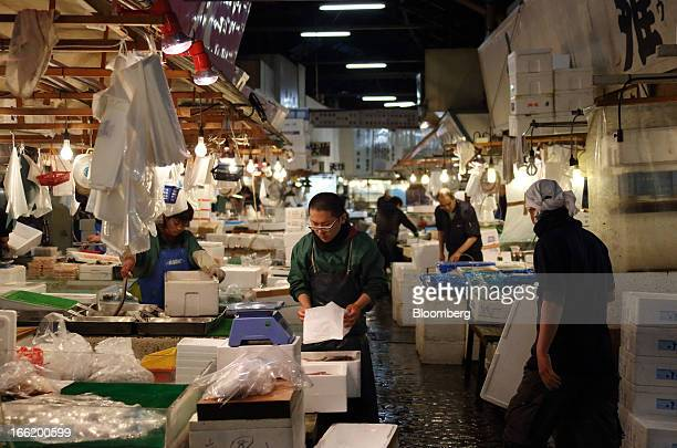 Wholesalers work at Tsukiji Market in Tokyo Japan on Tuesday April 9 2013 After Bank of Japan Governor Haruhiko Kuroda's first policy meeting as...