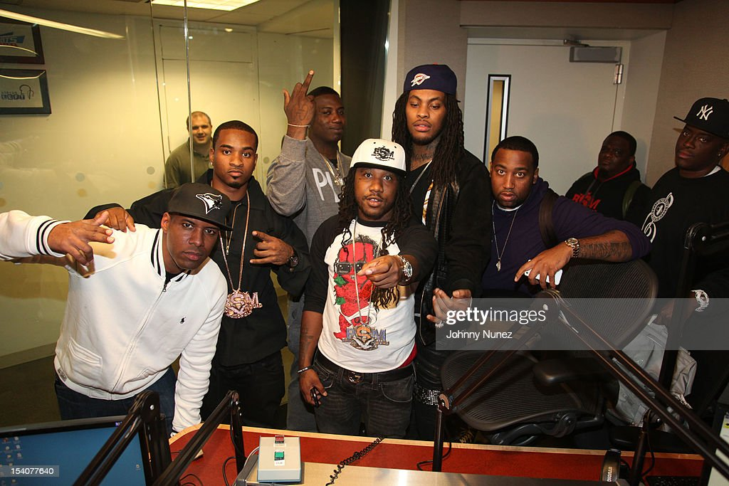 DJ Whoo Kid (L), Gucci Mane (centerL), Waka Flocka Fame (centerR) and guests invade 'The Whoolywood Shuffle' at SiriusXM Studios on October 8, 2012 in New York City.