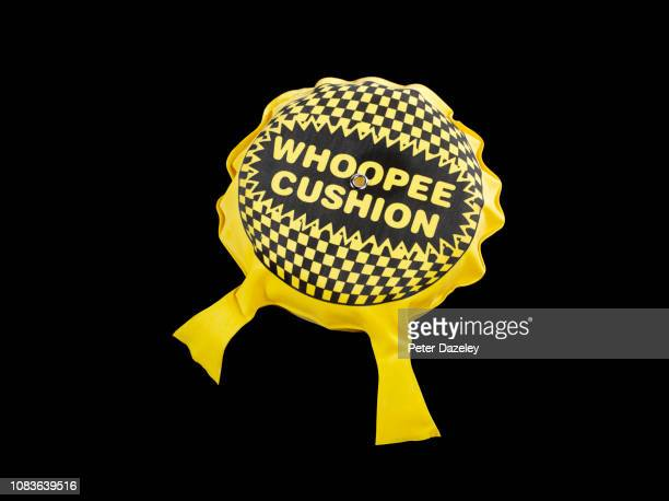 whoopee cushion - fart stock pictures, royalty-free photos & images