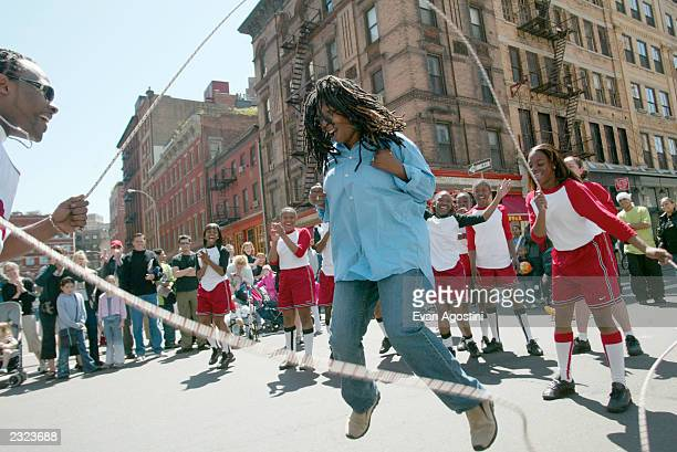 Whoopi Goldberg jumping rope double dutch style at the Tribeca Family Festival Street Fair presented by American Express on Greenwich Street in New...