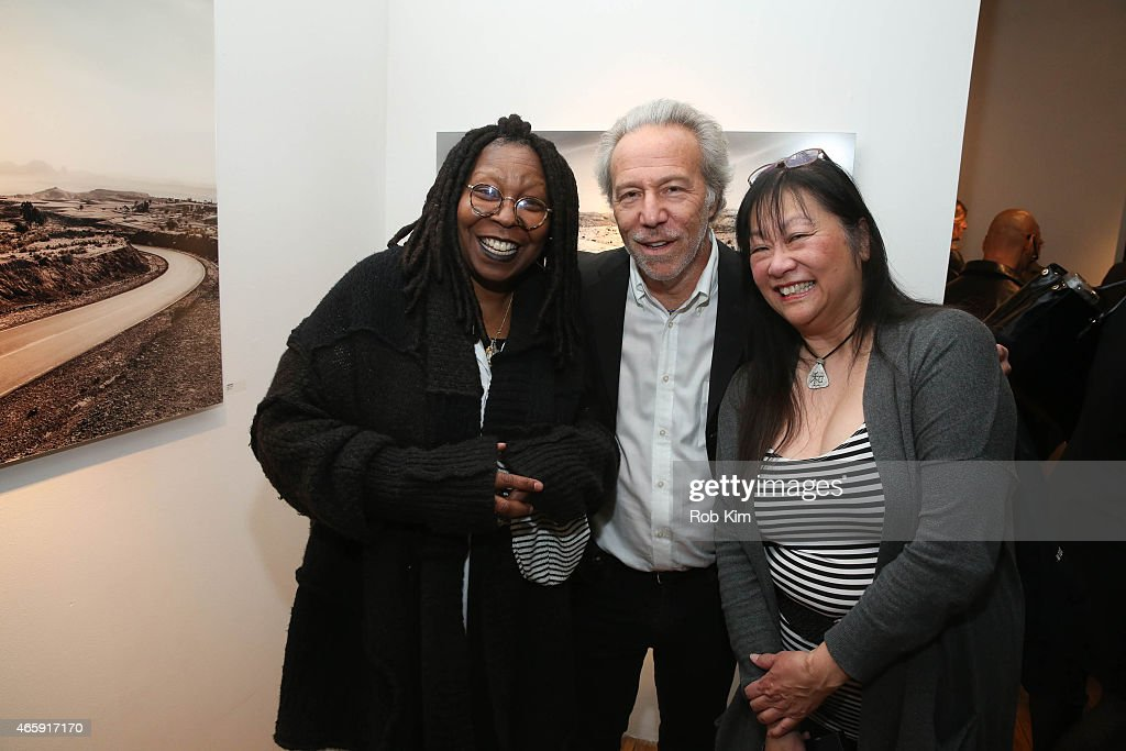Whoopi Goldberg, Mark J. Plotkin and May Pang attend Julian Lennon's 'Horizon' Exhibition Opening at Emmanuel Fremin Gallery on March 11, 2015 in New York City.