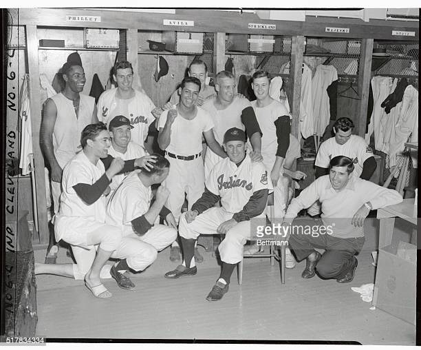 Whooping it up in the dressing room are a group of Indians celebrating their uphill 54 triumph over the Philadelphia A's in the eleventh innig which...