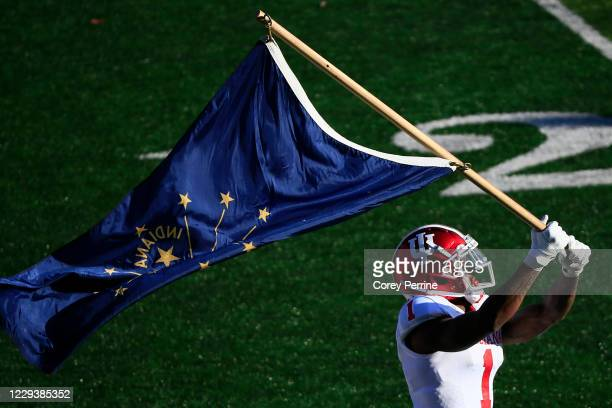 Whop Philyor of the Indiana Hoosiers waves the Indiana state flag before the game against the Rutgers Scarlet Knights at SHI Stadium on October 31,...