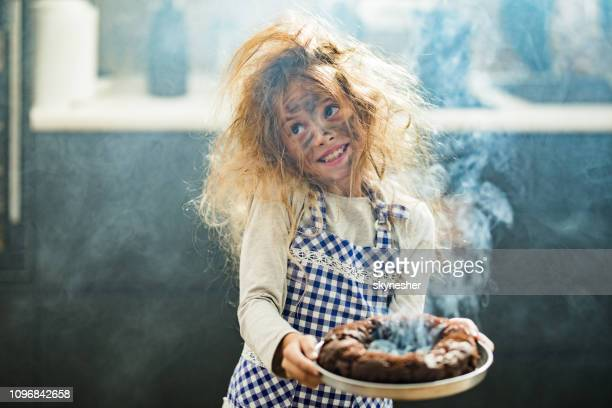 whops, i have burnt the cake! - imperfection stock pictures, royalty-free photos & images