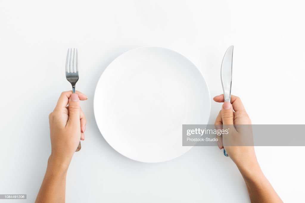 Whte plate with silver fork and knife on white background : Stock Photo