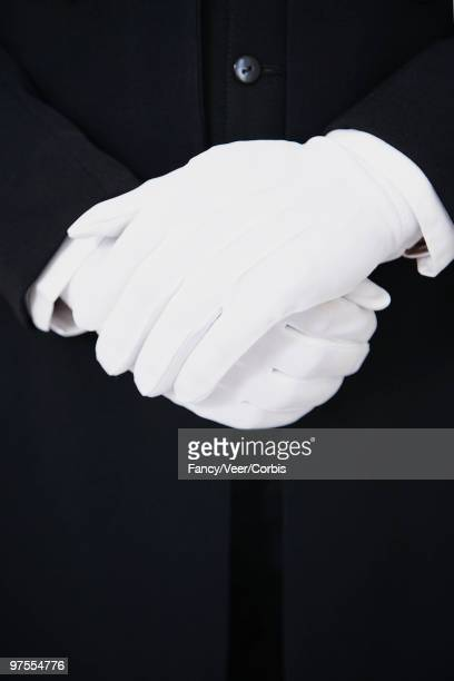 whtie gloves of butler in black uniform - glove stock pictures, royalty-free photos & images