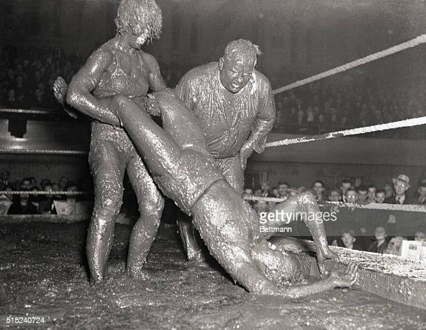 Why go to the beauty parlor for a mud bath when all you have to do is to turn wrestler in the new Hindu mud manner Here are Mildred Cyclone Burke...