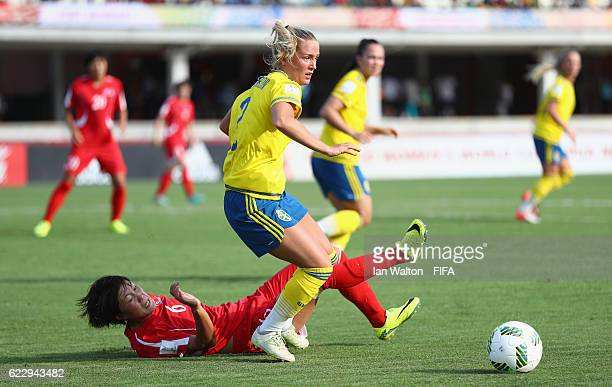 Wi Jong Sim of Korea DPR tries to tackle Ronja Othilia Gunilla Aronsson of Sweden during the FIFA U20 Women's World Cup Group A match between Sweden...