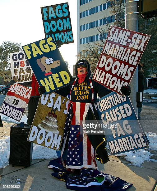 Wichita Kansas 11172014 Members of the Westboro Baptist Church protest outside the Sedgwich County Courthouse today prior to the weddings of about 20...