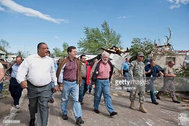 Wichita Mayor Carl Brewer Kansas Gov Sam Brownback Sedgwick County Commissioner Chariman Tim Norton and Maj Gen Lee Tafanelli tour the tornadodamaged...