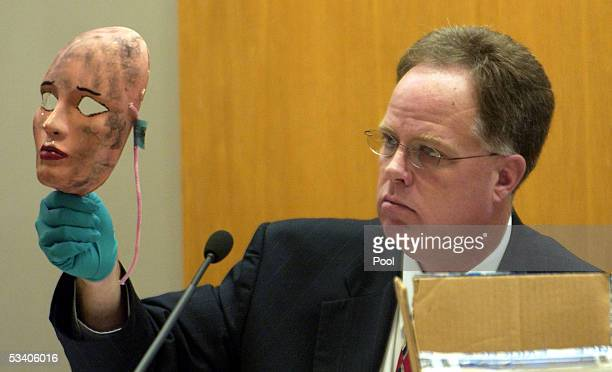 Wichita Police Det Sam Houston shows a mask which was used in one of the crimes during Dennis L Rader's sentencing hearing August 18 2005 in Wichita...