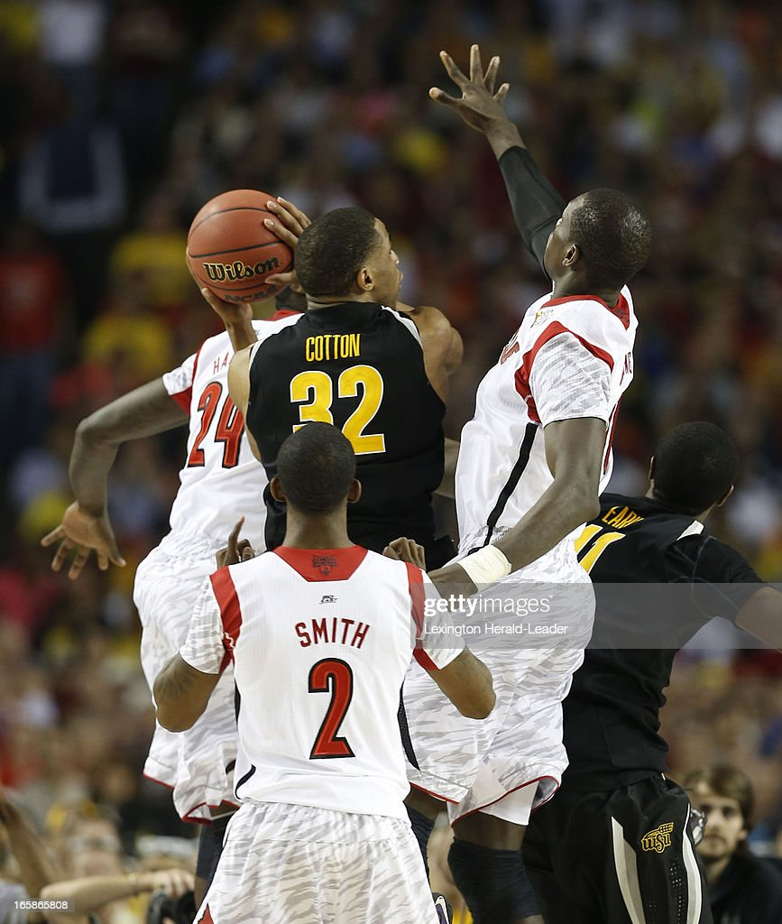 Wichita State guard Tekele Cotton (32) battles through Louisville defenders Gorgui Dieng (10) and Montrezl Harrell (24) in the NCAA Men's Basketball Championship at the Georgia Dome in Atlanta, Georgia, Saturday, April 6, 2013.