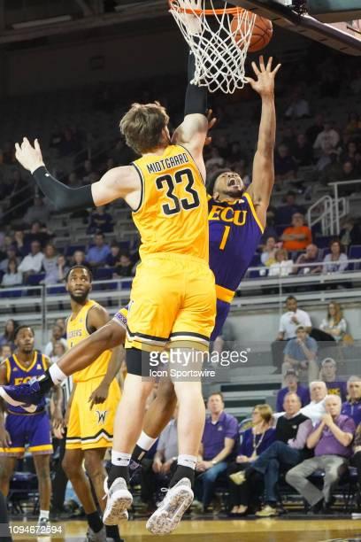 Wichita State Shockers center Asbjorn Midtgaard guards East Carolina Pirates forward Jayden Gardner driving to the basket during a game between the...