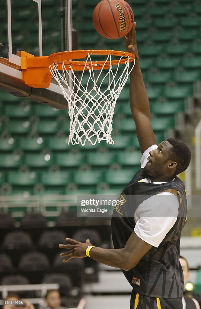 Wichita State Shockers center Ehimen Orukpe (21) dunks during practice at Energy Solutions Arena in Salt Lake City, Utah, Wednesday, March 20, 2013. WSU will face Pittsburgh in the second round of the NCAA tournament on Thursday.