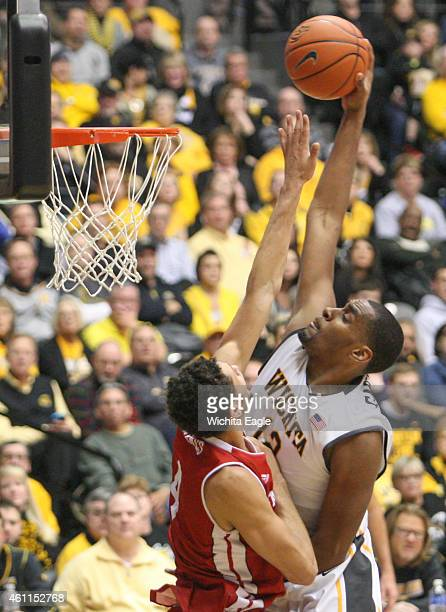 Wichita State Shockers forward Darius Carter goes up for a dunk over Bradley Braves forward Auston Barnes during the second half on Wednesday Jan 7...