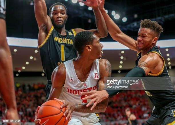Wichita State Shockers forward Markis McDuffie and Wichita State Shockers guard Dexter Dennis trap Houston Cougars guard Armoni Brooks during the...