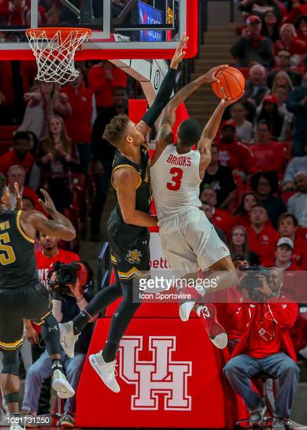 Wichita State Shockers guard Dexter Dennis blocks a shot by Houston Cougars guard Armoni Brooks during the basketball game between the Wichita State...