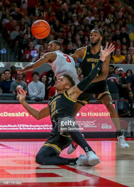 Wichita State Shockers guard Dexter Dennis falls backward as he tries to recover the rebound during the basketball game between the Wichita State...